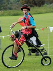 Juggling Jake on his penny farthing