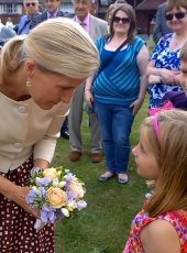 Sophie Perkins (age 5) presents Her Royal Highness with a posy of flowers