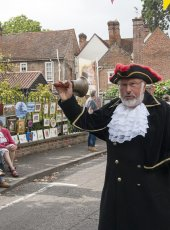 The Cobham Heritage Day Town Crier making an announcement