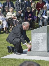 18 - Ian Taylor MP, OBE, Member of Parliament for Esher & Walton places a wreath by the Memorial Plaque