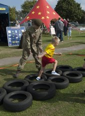 The Army Cadets put a youngster through some tyre training