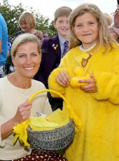 Emily Banfield (age 6) presents Her Royal Highness with the Winning Duck from the Duck Race