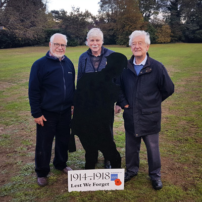 Sir Gerry Acher - Cobham Heritage Chairman, David Tipping - Cobham Heritage Vice Chairman and David Bellchamber - Cobham Royal British Legion Chairman positioning the 'Silent Soldier'