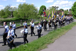 Members of the Royal British Legion led by the Hook Scout and Guide band